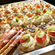Variety of finger food on catering event. Shalloe focus